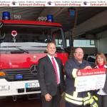Feuerwehr im Einsatz: Sparkassen-Spendenscheck in Abwesenheit